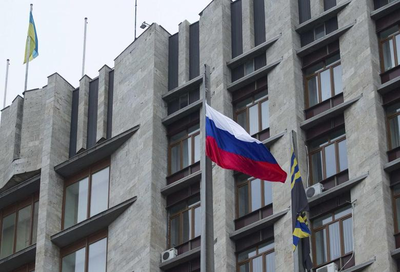 The Russian flag is raised next to a regional government office in central Donetsk March 1, 2014. REUTERS/Stringer