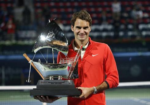 Federer subdues Berdych to win sixth Dubai title