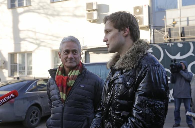 American gold medallist Olympic diver Greg Louganis (L) and Konstantin Yablotskiy, president of the Russian LGBT Sport Federation, speak to the media in Moscow February 26, 2014. REUTERS/Maxim Shemetov