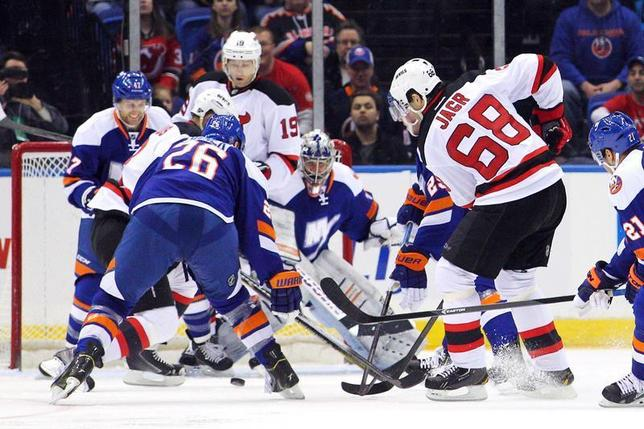 Mar 1, 2014; Uniondale, NY, USA; New Jersey Devils right wing Jaromir Jagr (68) scores a goal against New York Islanders goalie Evgeni Nabokov (20) during the second period of a game at Nassau Veterans Memorial Coliseum. The goal was the 700th of Jagr's career. Brad Penner-USA TODAY Sports