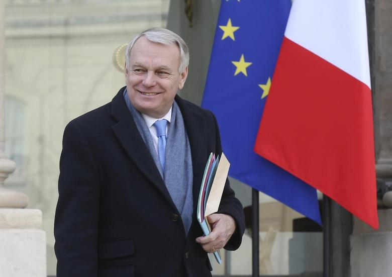 French Prime Minister Jean-Marc Ayrault leaves the weekly cabinet meeting at the Elysee Palace in Paris February 26, 2014. REUTERS/Jacky Naegelen