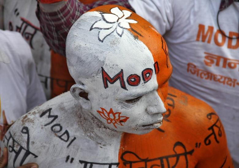 A supporter of India's main opposition Bharatiya Janata Party (BJP) with his body painted attends a rally addressed by Hindu nationalist Narendra Modi, prime ministerial candidate for BJP and Gujarat's chief minister, in the northern Indian city of Lucknow March 2, 2014. REUTERS/Pawan Kumar
