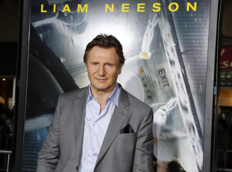 Actor Liam Neeson poses at the premiere of his new film ''Non-Stop'' in Los Angeles February 24, 2014. REUTERS/Fred Prouser