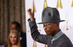 Rapper Pharrell Williams arrives at the 86th Academy Awards nominees luncheon in Beverly Hills, California February 10, 2014. REUTERS/Mario Anzuoni