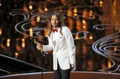 "Jared Leto, best supporting actor winner for his role in ""Dallas Buyers Club"", speaks on stage at the 86th Academy Awards in Hollywood, California March 2, 2014. REUTERS/Lucy Nicholson"