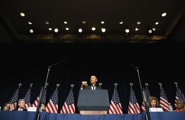 U.S. President Barack Obama addresses the winter meeting of the Democratic National Committee in Washington February 28, 2014 file photo. REUTERS/Jonathan Ernst