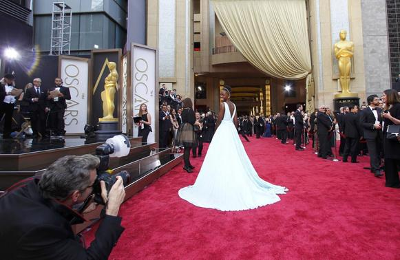 Lupita Nyong'o, best supporting actress nominee for her role in '12 years a Slave', arrives on the red carpet at the 86th Academy Awards in Hollywood, California March 2, 2014. REUTERS-Mike Blake