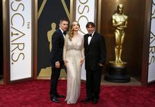 "Ethan Hawke, Julie Delpy and Richard Linklater, best adapted screenplay nominees for their film ""Before Midnight"" pose at the 86th Academy Awards in Hollywood, California March 2, 2014. REUTERS/Lucas Jackson"
