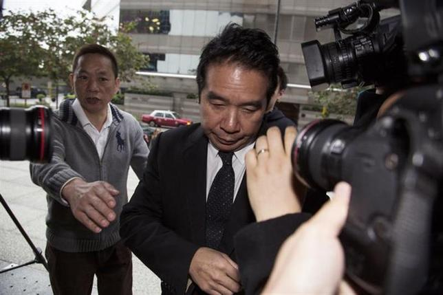 Former Birmingham City Football Club owner Carson Yeung arrives at a district court in Hong Kong February 28, 2014. REUTERS/Stringer