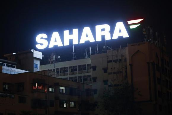 An electronic billboard advertising Sahara Group is seen on top of a building at a residential area in Mumbai March 15, 2013. REUTERS/Danish Siddiqui/Files