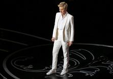 Host Ellen Degeneres stands on stage at the 86th Academy Awards in Hollywood, California March 2, 2014. REUTERS/Lucy Nicholson