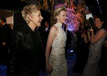 Academy Awards host Ellen Degeneres and her partner Portia de Rossi at the Governors Ball after the 86th Academy Awards in Hollywood, California March 2, 2014. REUTERS/Adrees Latif