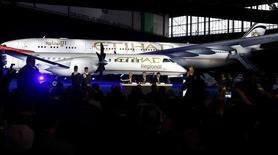 Selon le directeur général Etihad Airways, James Hogan, la décision finale du groupe au sujet d'un investissement dans Alitalia pourrait aller dans un sens comme dans l'autre, en fonction des réponses apportées aux conditions posées par la compagnie aérienne basée à Abou Dhabi. /Photo prise le 16 janvier 2014/REUTERS/Arnd Wiegmann