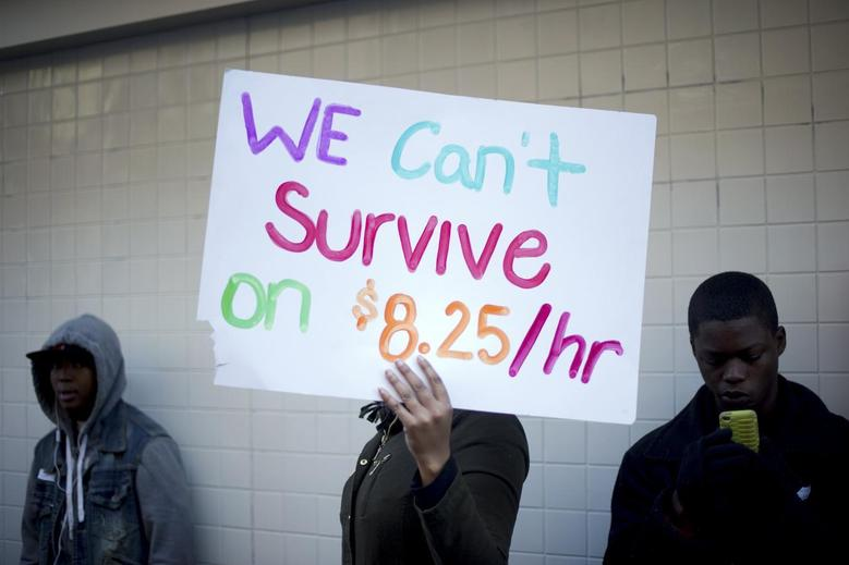 Protesters calling for higher wages for fast-food workers stand outside a McDonald's restaurant in Oakland, California December 5, 2013. REUTERS/Noah Berger