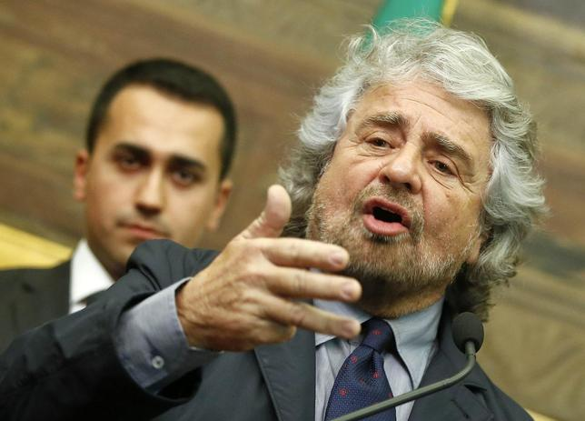 Leader of the 5-Star movement and comedian Beppe Grillo talks to reporters at the end of consultations with Italian Prime Minister-designate Matteo Renzi at the Parliament in Rome February 19, 2014. REUTERS/Tony Gentile