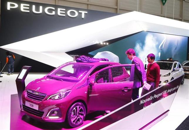 People check a Peugeot 108 car ahead of the 84th Geneva Motor Show at the Palexpo Arena in Geneva March 3, 2014. REUTERS/Arnd Wiegmann