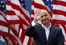 Two-time U.S. Open champion Andre Agassi waves before being inducted into the U.S. Open Court of Champions, which celebrates the legacy of the greatest singles champions in the history of the tournament, in New York September 9, 2012. REUTERS/Kevin Lamarque