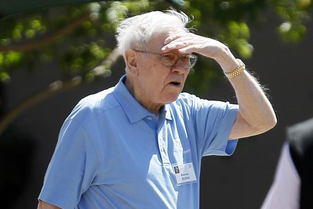 Warren Buffet, CEO of Berkshire Hathaway, leaves the first session of the annual Allen and Co. conference at the Sun Valley, Idaho Resort July 10, 2013. REUTERS/Rick Wilking