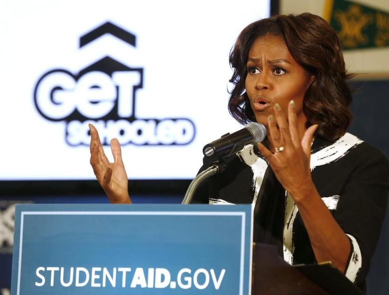 First lady Michelle Obama delivers remarks at a Free Application for Federal Student Aid Workshop at T.C. Williams High School-King Street Campus in Alexandria, Virginia, February 5, 2014. REUTERS/Larry Downing