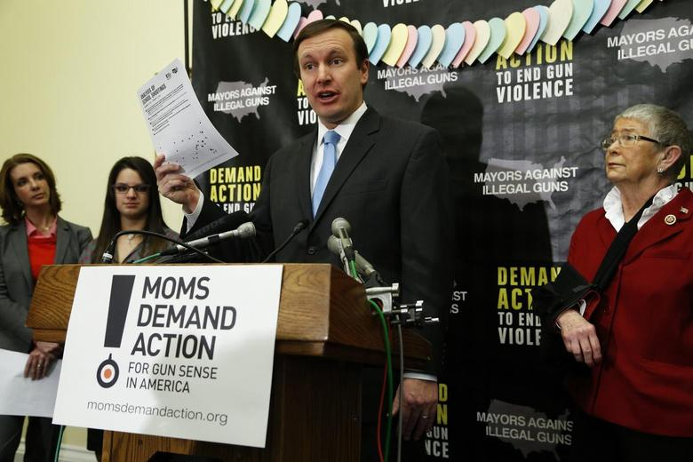 U.S. Senator Chris Murphy (D-CT) (C) speaks at a news conference held by the groups Mayors Against Illegal Guns and Moms Demand Action for Gun Sense in America, on Capitol Hill in Washington, February 12, 2014. REUTERS/Jonathan Ernst