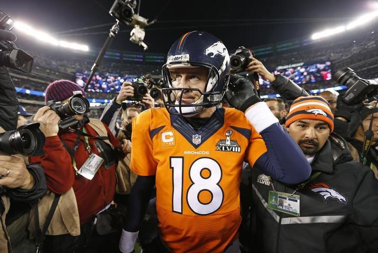 Denver Broncos quarterback Peyton Manning leaves field after being defeated by the Seattle Seahawks in the NFL Super Bowl XLVIII football game in East Rutherford, New Jersey, February 2, 2014. REUTERS/Carlo Allegri