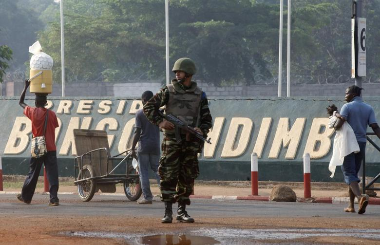 A Moroccan soldier from the peacekeeping forces secures a street in Bangui February 20, 2014. REUTERS/Luc Gnago