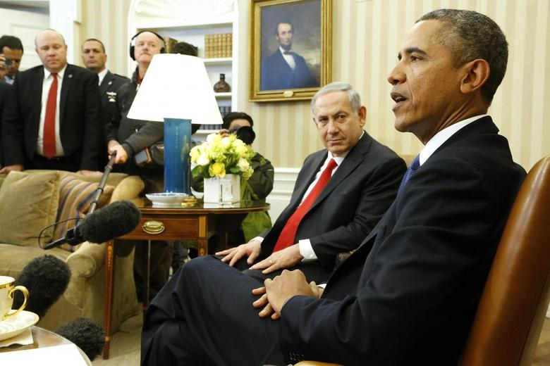 Israel's Prime Minister Benjamin Netanyahu (2nd R) listens to remarks by U.S. President Barack Obama (R) as they sit down to meet in the Oval Office of the White House in Washington March 3, 2014. REUTERS/Jonathan Ernst