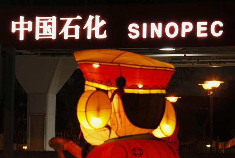 A Chinese New Year lantern installation is displayed outside a Sinopec gas station in Hong Kong February 5, 2013. REUTERS/Bobby Yip