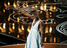 "Lupita Nyong'o, best supporting actress winner for her role in ""12 Years a Slave"", speaks on stage at the 86th Academy Awards in Hollywood, California March 2, 2014. REUTERS/Lucy Nicholson"