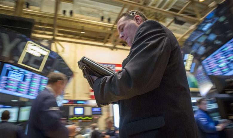 Traders work on the floor of the New York Stock Exchange March 3, 2014. REUTERS/Brendan McDermid