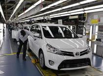 Employees work at an assembly line at the Toyota manufacturing plant in Sakarya October 10, 2013. REUTERS/Osman Orsal