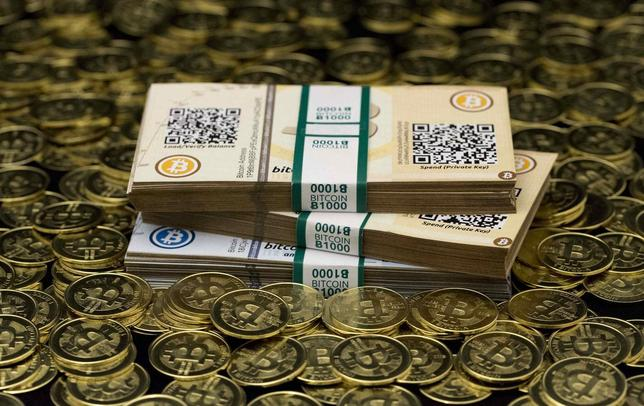 Some of Bitcoin enthusiast Mike Caldwell's coins and paper vouchers, often called ''paper wallets'', are pictured at his office in this photo illustration in Sandy, Utah, January 31, 2014. REUTERS/Jim Urquhart