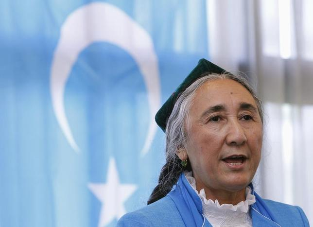Uighur leader Rebiya Kadeer delivers a speech in front of a East Turkestan flag at the fourth General Assembly of the World Uighur Congress (WUC) in Tokyo May 14, 2012 file photo. REUTERS/Yuriko Nakao