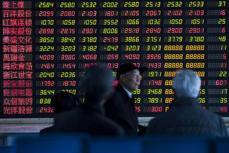 Investors look at information displayed on an electronic screen at a brokerage house in Shanghai, March 4, 2014. REUTERS/Aly Song