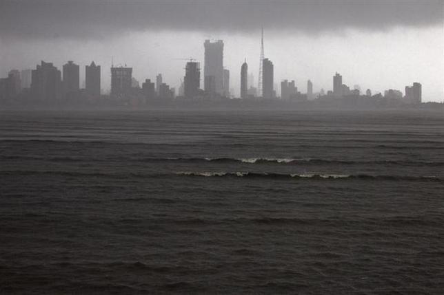 Clouds loom over the Mumbai skyline July 5, 2012. REUTERS/Ahmad Masood/Files