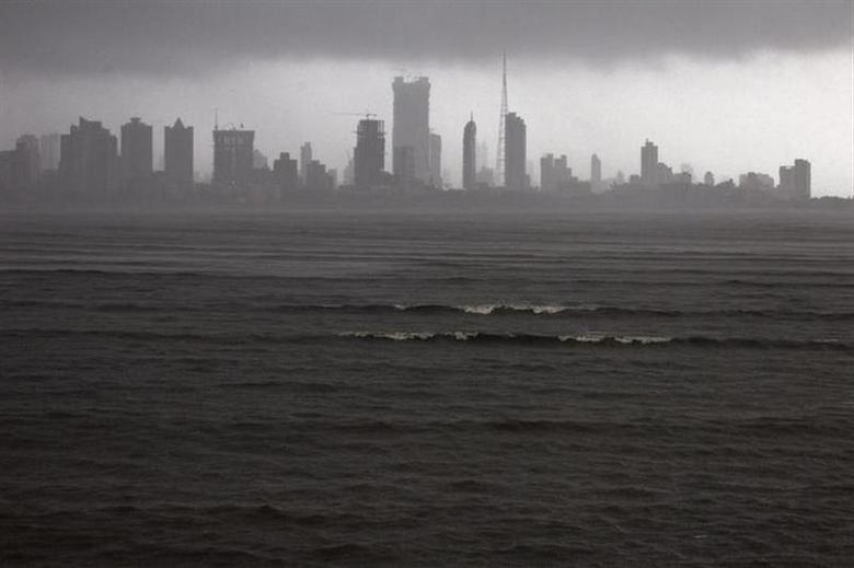 Clouds loom over the Mumbai skyline July 5, 2012. REUTERS/Ahmad Masood/Files