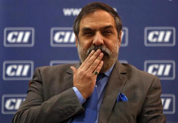 Trade Minister Anand Sharma gestures as he speaks with the media after interacting with students at a college in Mumbai February 11, 2014. REUTERS/Mansi Thapliyal
