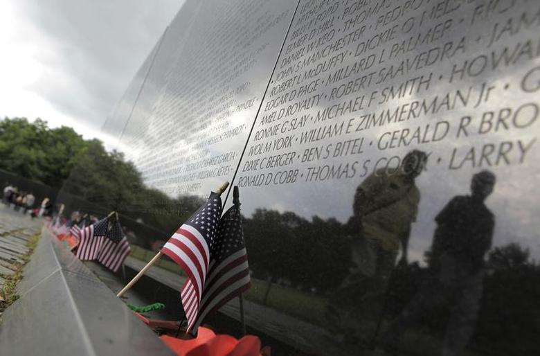 Visitors are reflected in the Vietnam Veterans Memorial wall, etched with the names of more than 58,000 U.S. servicemen and women who died in the war, in Washington May 23, 2013. REUTERS/Yuri Gripas