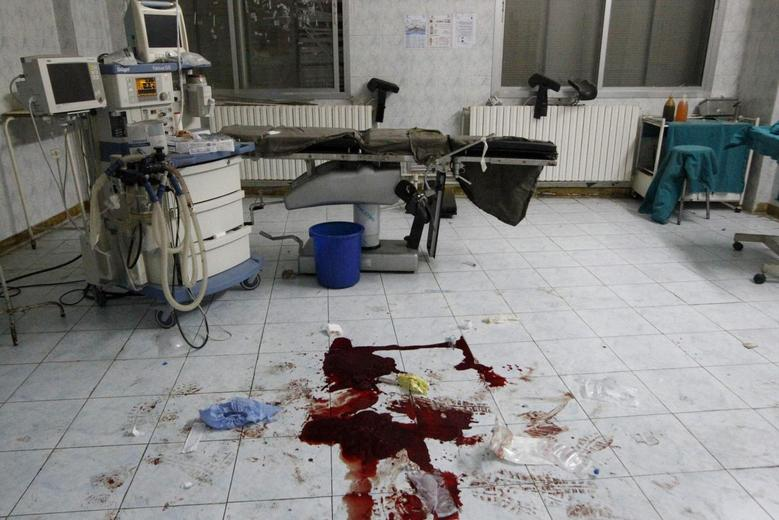 Blood is seen on a hospital floor in what activists say was shelling from forces loyal to President Bashar Al-Assad in Raqqa, eastern Syria September 14, 2013. Picture taken September 14, 2013. REUTERS/Nour Fourat