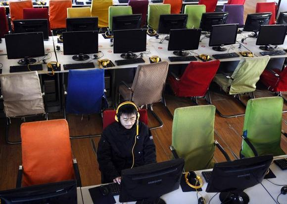 A customer uses a computer in an internet cafe at Changzhi, Shanxi province January 25, 2010. REUTERS/Stringer/Files