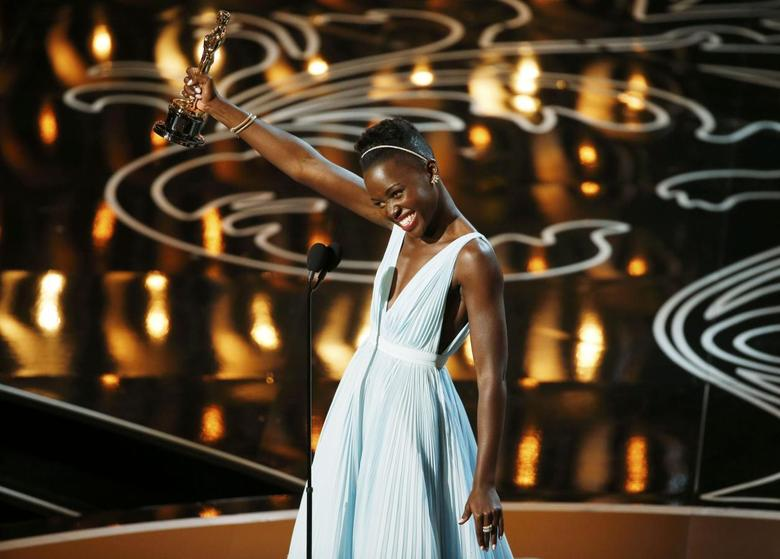 Lupita Nyong'o, best supporting actress winner for her role in ''12 Years a Slave'', speaks on stage at the 86th Academy Awards in Hollywood, California March 2, 2014. REUTERS/Lucy Nicholson
