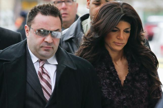 Teresa Giudice, 41, (R) and her husband Giuseppe ''Joe'' Giudice, 43, (L) arrive at the Federal Court in Newark, New Jersey, March 4, 2014. REUTERS/Eduardo Munoz