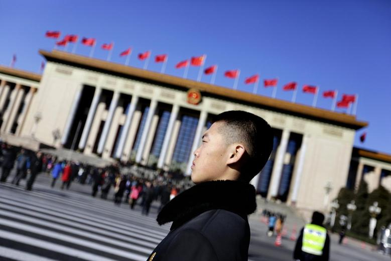 A soldier in plain clothes from the Chinese People's Liberation Army (PLA) stands guard in front of the Great Hall of the People, the venue of the annual session of China's parliament, the National People's Congress (NPC), in Beijing March 4, 2014. REUTERS/Jason Lee