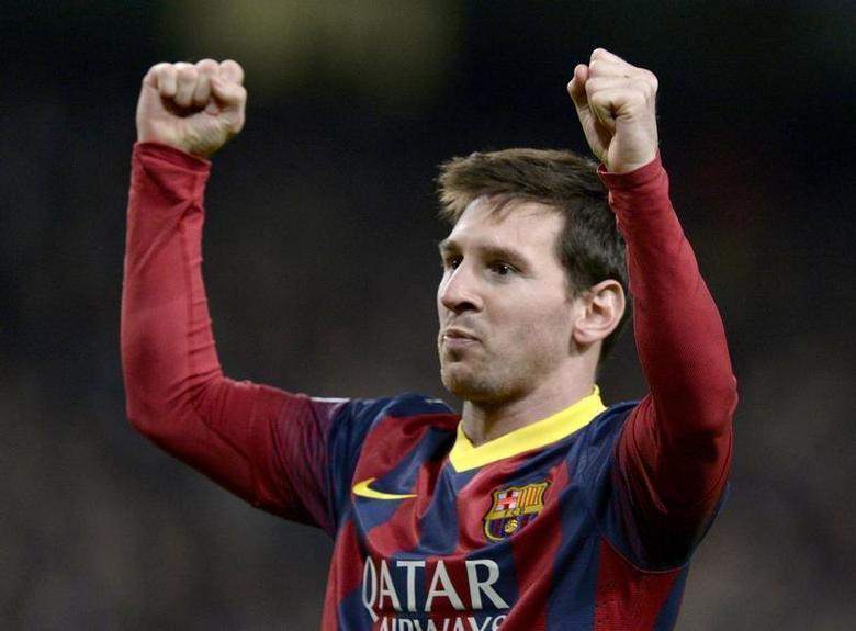 Barcelona's Lionel Messi celebrates after scoring a penalty against Manchester City during their Champions League round of 16 first leg soccer match at the Etihad Stadium in Manchester, northern England February 18, 2014. REUTERS/Nigel Roddis
