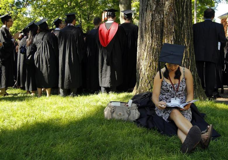 Graduating student Jennifer Lim sits in the shade before the start of the 361st Commencement Exercises at Harvard University in Cambridge, Massachusetts May 24, 2012. REUTERS/Brian Snyder