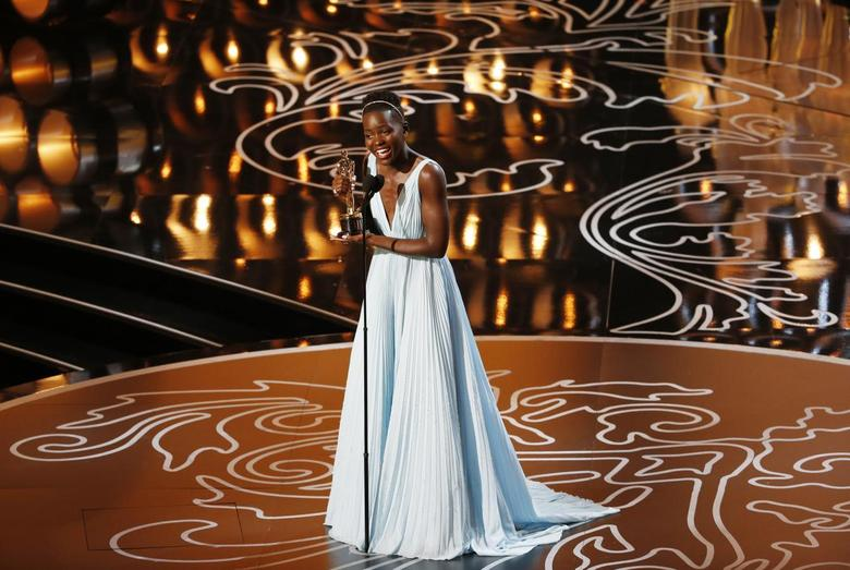 Lupita Nyong'o, best supporting actress winner for her role in ''12 Years a Slave'', reacts on stage at the 86th Academy Awards in Hollywood, California March 2, 2014. REUTERS/Lucy Nicholson