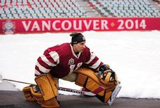 Mar 1, 2014; Vancouver, BC, Canada; Vancouver Canucks goaltender Roberto Luongo (1) warms up off ice during practice the day before the Heritage Classic hockey game against the Ottawa Senators at BC Place. Mandatory Credit: Anne-Marie Sorvin-USA TODAY Sports