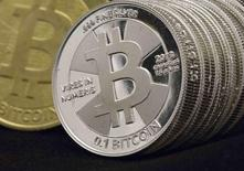 Some of Bitcoin enthusiast Mike Caldwell's coins are pictured at his office in this photo illustration in Sandy, Utah, January 31, 2014. REUTERS/Jim Urquhart
