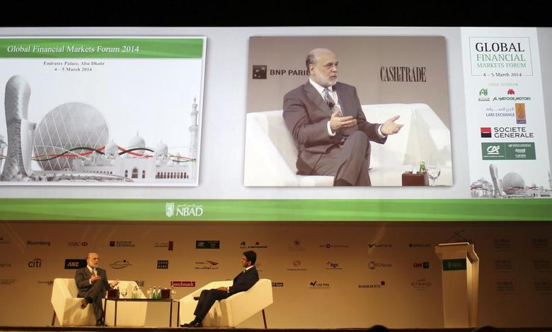 Former Federal Reserve Chairman Ben Bernanke (L) talks during Global Financial Markets Forum in Abu Dhabi March 4, 2014. REUTERS/Ahmed Jadallah