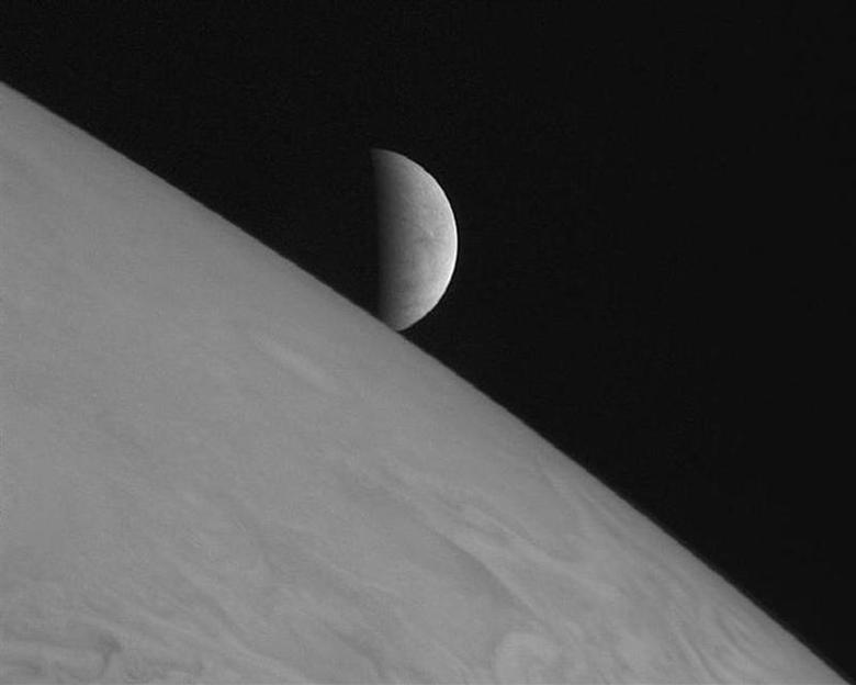 New Horizons took this image of the icy moon Europa rising above Jupiter's cloud tops after the spacecraft's closest approach to Jupiter. REUTERS/NASA/Johns Hopkins University Applied Physics Laboratory/Southwest Research Institute/Handout